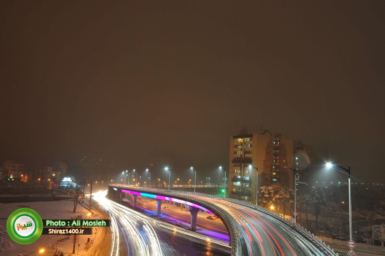 نورپردازی پل معالی آباد در شبی برفی